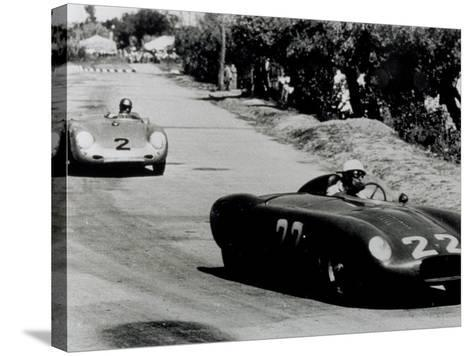 Two Racing Cars Whizzing by on a Road-A^ Villani-Stretched Canvas Print
