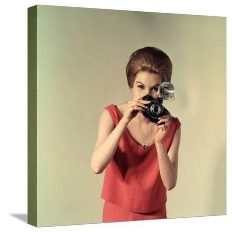 Young Woman Taking a Photograph-A^ Villani-Stretched Canvas Print