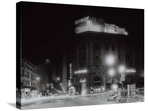 Night City View with Neon Signs of the New Fiat 500 Located on the Roof of a Building-A^ Villani-Stretched Canvas Print