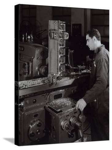 Ferrari Factory, a Worker Monitoring Machinery-A^ Villani-Stretched Canvas Print