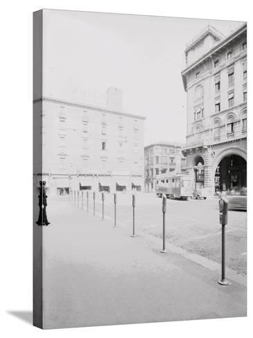 Parking Meters in Piazza Re Enzo in Bologna-A^ Villani-Stretched Canvas Print