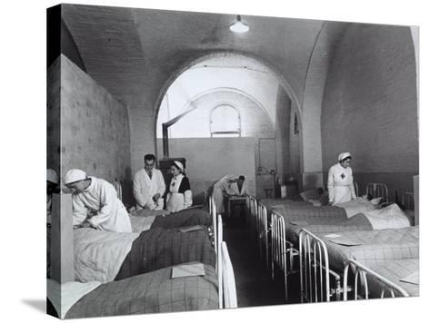 Nurses and Doctors Visiting the Bedridden in the Room of a Hosptial During World War II-A^ Villani-Stretched Canvas Print