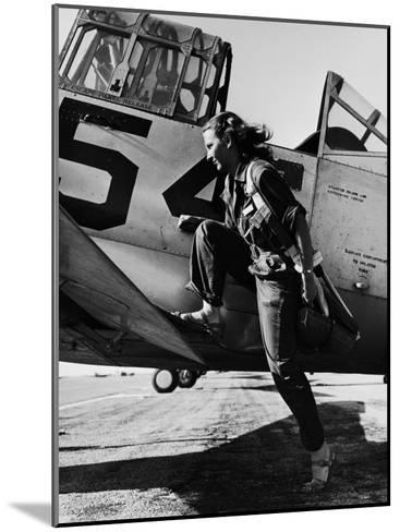 Female Pilot of the Us Women's Air Force Service Posed with Her Leg Up on the Wing of an Airplane-Peter Stackpole-Mounted Premium Photographic Print