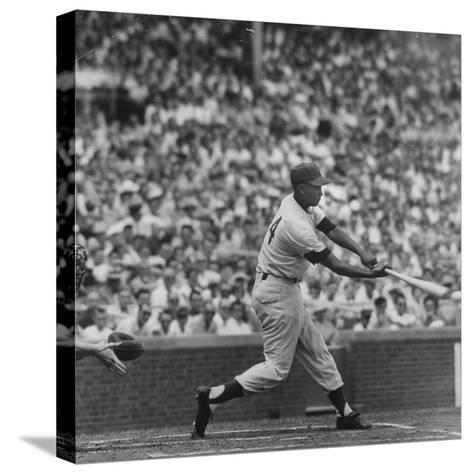 Action Shot of Chicago Cub's Ernie Banks Smacking the Pitched Baseball-John Dominis-Stretched Canvas Print