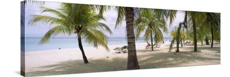 Sunning Tourists on 7-Mile Beach, Negril, Jamaica--Stretched Canvas Print