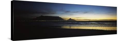 Silhouette of Table Mountain at Sunset, Table Bay, Bloubergstrand, Cape Winelands, South Africa--Stretched Canvas Print