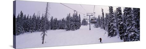 Ski Lift Passing over a Snow Covered Landscape, Keystone Resort, Keystone, Colorado, USA--Stretched Canvas Print