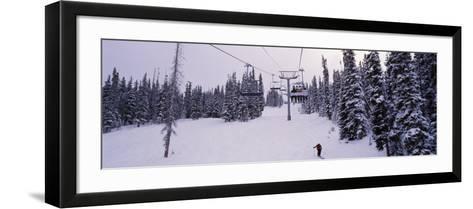 Ski Lift Passing over a Snow Covered Landscape, Keystone Resort, Keystone, Colorado, USA--Framed Art Print