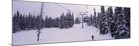 Ski Lift Passing over a Snow Covered Landscape, Keystone Resort, Keystone, Colorado, USA--Mounted Photographic Print