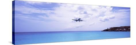 Airplane Flying over Sea, Princess Juliana International Airport, Maho Beach, Netherlands Antilles--Stretched Canvas Print