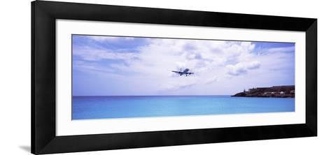 Airplane Flying over Sea, Princess Juliana International Airport, Maho Beach, Netherlands Antilles--Framed Art Print