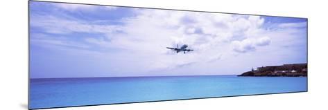 Airplane Flying over Sea, Princess Juliana International Airport, Maho Beach, Netherlands Antilles--Mounted Photographic Print