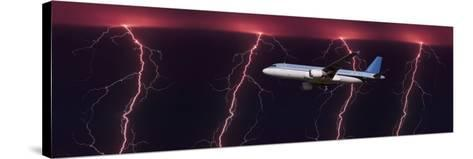 Airplane in Flight Through a Lighting and Rain Storm--Stretched Canvas Print