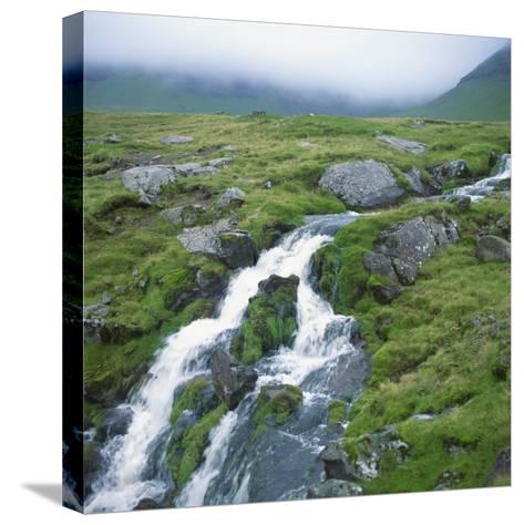 Stream Rushing over Rocks in a Wet Misty Environment, Estoroy Island, Faroe Islands, Denmark-David Lomax-Stretched Canvas Print