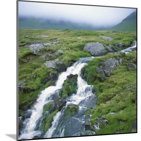 Stream Rushing over Rocks in a Wet Misty Environment, Estoroy Island, Faroe Islands, Denmark-David Lomax-Mounted Photographic Print