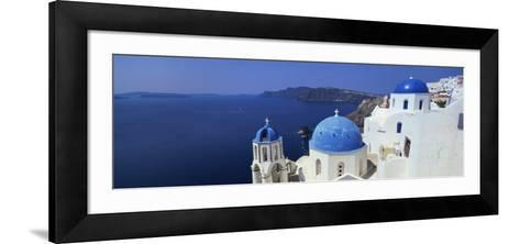 Oia with Blue-Domed Churches and Whitewashed Buildings, Santorini, Cyclades, Greek Islands, Greece-Lee Frost-Framed Art Print