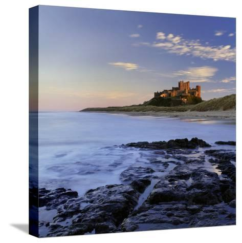 Bamburgh Castle Bathed in Warm Evening Light, Bamburgh, Northumberland, England, United Kingdom-Lee Frost-Stretched Canvas Print