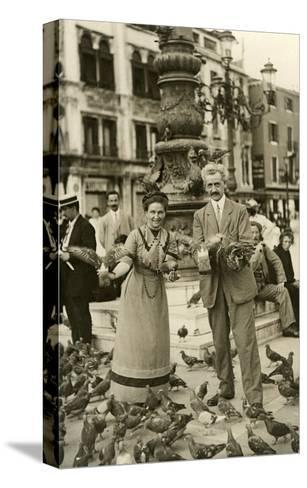 Feeding the Pigeons in the City Square--Stretched Canvas Print