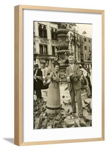 Feeding the Pigeons in the City Square--Framed Art Print