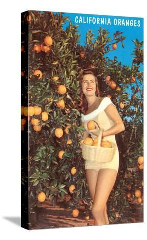 Woman with Oranges in Basket, California--Stretched Canvas Print