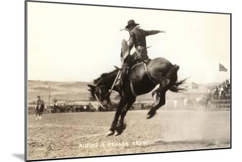 Riding a Nevada Bronco--Mounted Art Print