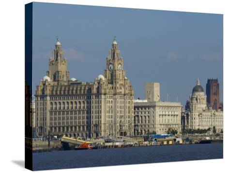 Thethree Graces and Cathedral from the River Mersey Ferry, Liverpool, Merseyside, England, UK-Charles Bowman-Stretched Canvas Print