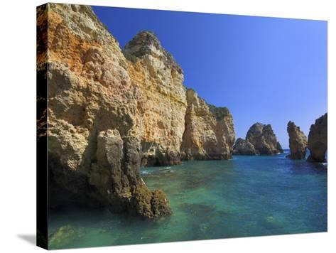 Rock Arches and Cliffs at Ponte Da Piedade Near Lagos, Algarve, Portugal, Europe-Neale Clarke-Stretched Canvas Print
