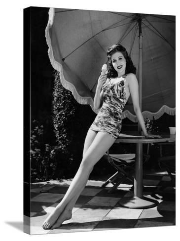 Ann Miller Eating Ice Cream, c.1941--Stretched Canvas Print