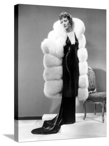 Claudette Colbert, in Travis Banton Gown and White Fox Fur Coat, c.1935--Stretched Canvas Print