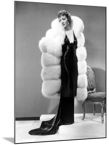 Claudette Colbert, in Travis Banton Gown and White Fox Fur Coat, c.1935--Mounted Photo