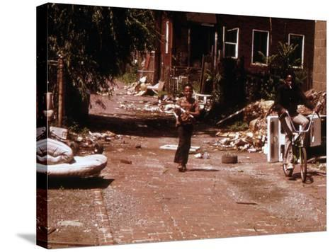 1970s America, Two Young Boys Pass Through a Trash-Strewn Alley of Chicago, Early 1973S--Stretched Canvas Print