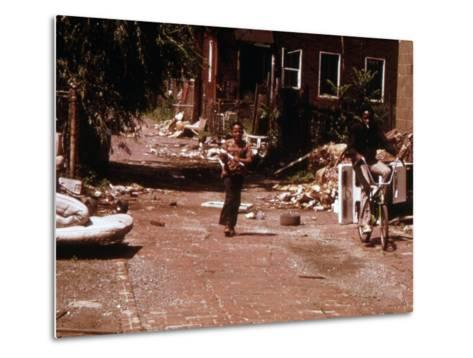 1970s America, Two Young Boys Pass Through a Trash-Strewn Alley of Chicago, Early 1973S--Metal Print