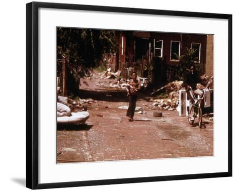 1970s America, Two Young Boys Pass Through a Trash-Strewn Alley of Chicago, Early 1973S--Framed Art Print