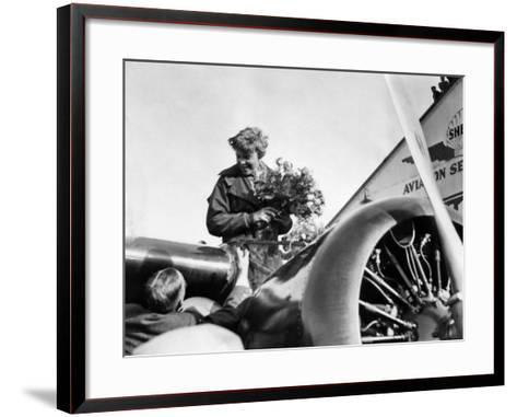Amelia Earhart Just after Landing in Oakland, on First Solo Flight across Pacific, January 12, 1935--Framed Art Print