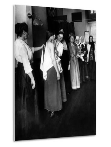 Women Immigrants Undegoing a Physical Examination, Ellis Island, New York, 1910--Metal Print