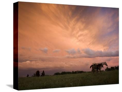 A receding thunderstorm creates a blazing sunset-Jim Richardson-Stretched Canvas Print