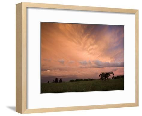 A receding thunderstorm creates a blazing sunset-Jim Richardson-Framed Art Print