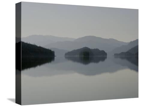 Clearing fog hangs above islands and scenery-Melissa Farlow-Stretched Canvas Print