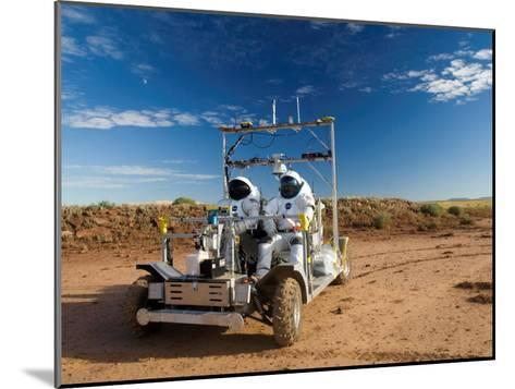Astronauts test a surface transport vehicle in the Arizona desert--Mounted Photographic Print