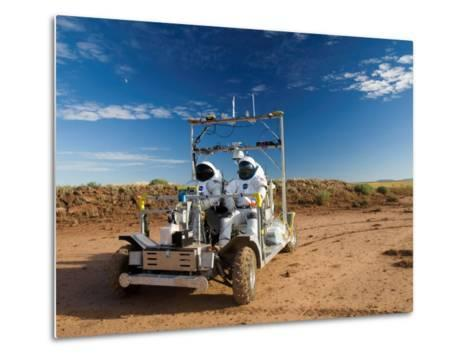 Astronauts test a surface transport vehicle in the Arizona desert--Metal Print