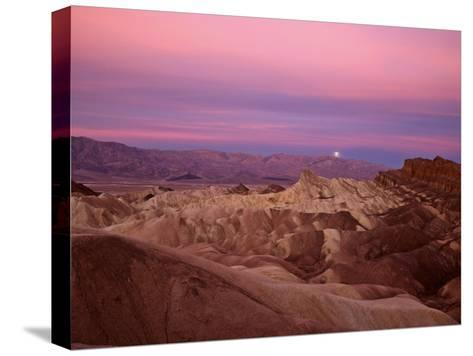 Full moon setting over Manly Beacon at Zabriskie Point-Michael Melford-Stretched Canvas Print