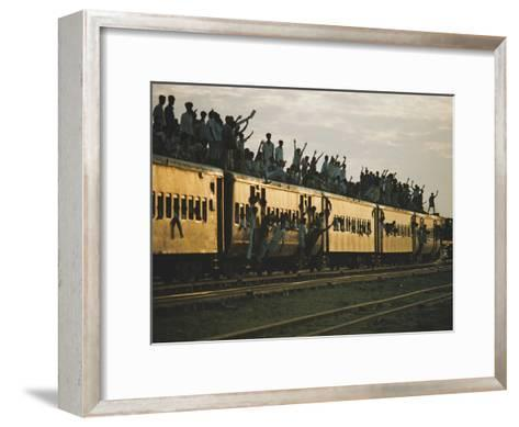 Famine refugees crowd aboard a train bound for the capital, Dacca-Steve Raymer-Framed Art Print