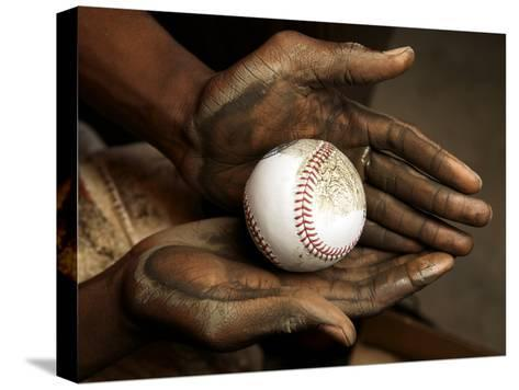 Balls are rubbed with mud before every major league baseball game-Rebecca Hale-Stretched Canvas Print