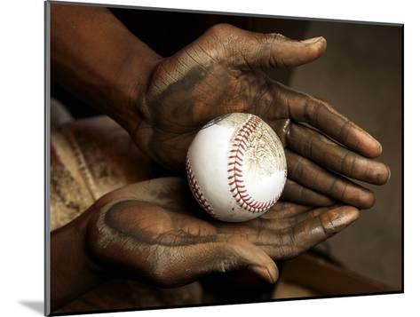 Balls are rubbed with mud before every major league baseball game-Rebecca Hale-Mounted Photographic Print
