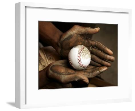 Balls are rubbed with mud before every major league baseball game-Rebecca Hale-Framed Art Print