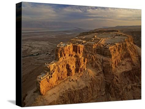 Herod's three-tiered palace cascades down the north face of Masada-Michael Melford-Stretched Canvas Print
