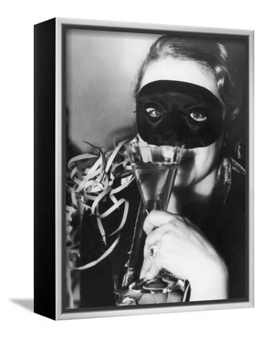Woman in Mask Celebrating at a New Years Party--Framed Canvas Print