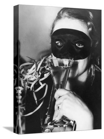 Woman in Mask Celebrating at a New Years Party--Stretched Canvas Print