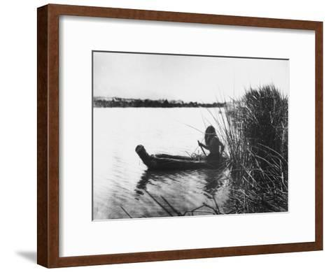 Pomo Indian Poling His Boat Made of Tule Rushes Through Shallows of Clear Lake, Northen California-Edward S^ Curtis-Framed Art Print
