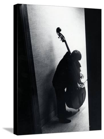 Young Bassist Member of Alexander Schneider's New York String Orchestra Tuning His Instrument-Gjon Mili-Stretched Canvas Print